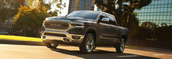 2019 RAM 1500 driving down city street